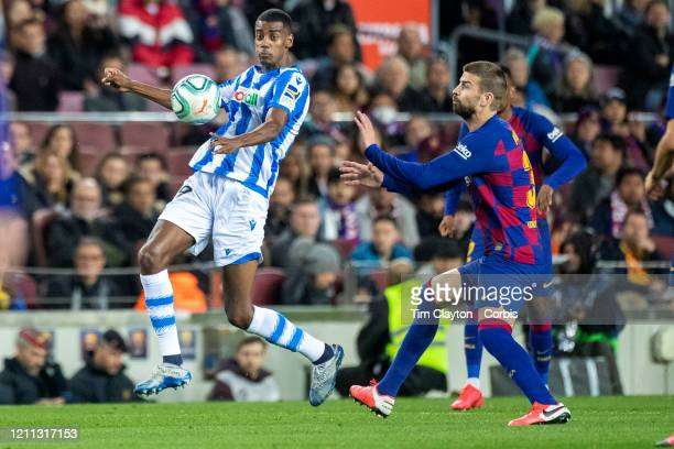 Alexander Isak of Real Sociedad defended by Gerard Pique of Barcelona during the Barcelona V Real Sociedad La Liga regular season match at Estadio...