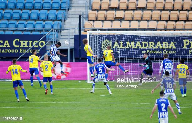 Alexander Isak of Real Sociedad scores their sides first goal past Jeremias Ledesma of Cadiz CF during the La Liga Santander match between Cadiz CF...