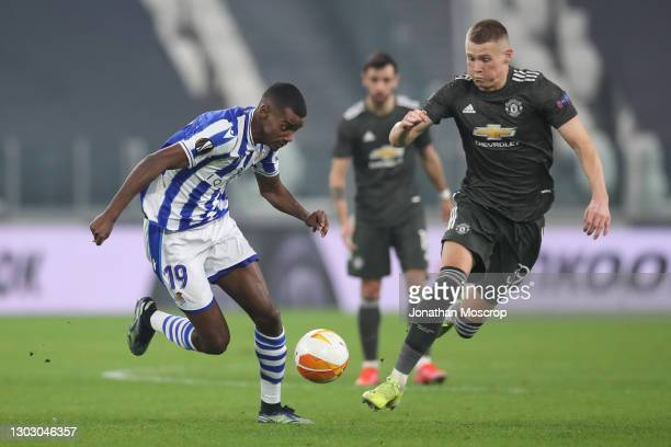 Alexander Isak of Real Sociedad takes on Scott McTominay of Manchester United during the UEFA Europa League Round of 32 match between Real Sociedad...