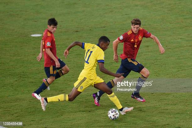 Alexander Isak of Sweden and Pau Torres of Spain during the match between Spain and Sweden of Euro 2020, group E, matchday 1, played at La Cartuja...