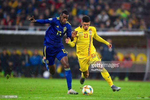 Alexander Isak of Sweden in action against Florinel Coman of Romaniaduring the UEFA Euro 2020 Qualifier between Romania and Sweden at Arena Nationala...