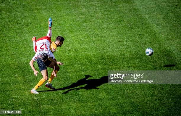 Alexander Jeremejeff of Dresden is challenged by Oliver Hein of Regensburg during the Second Bundesliga match between SG Dynamo Dresden and SSV Jahn...