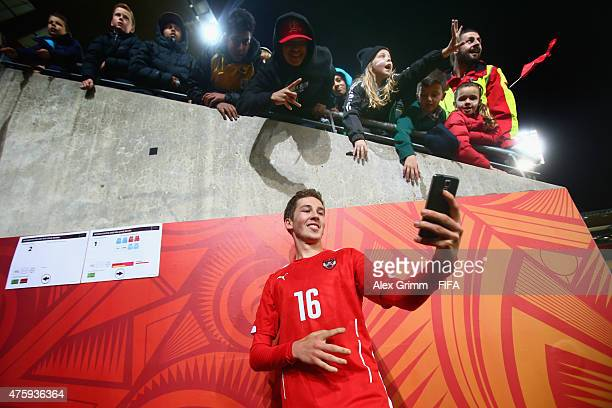 Alexander Joppich of Austria takes a selfie with fans after the FIFA U20 World Cup New Zealand 2015 Group B match between Austria and Argentina at...