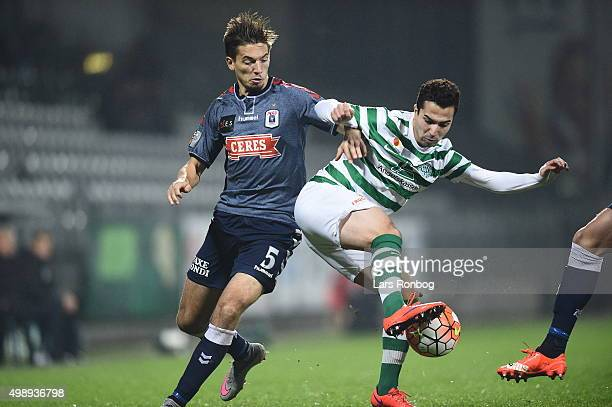 Alexander Juel Andersen of AGF Aarhus and Osama Akharraz of Viborg FF compete for the ball during the Danish Alka Superliga match between Viborg FF...