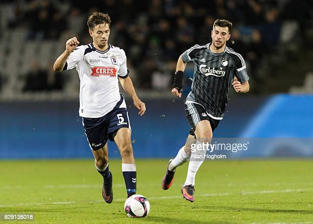Alexander Juel Andersen of AGF and Andrija Pavlovic of FC Copenhagen compete for the ball during the Danish Alka Superliga match between AGF Aarhus...