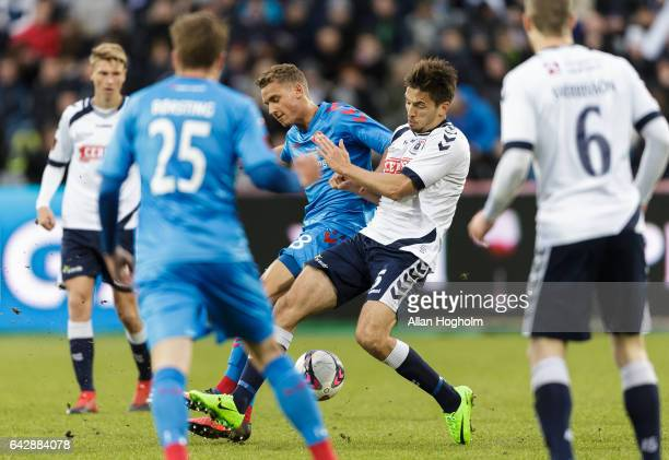 Alexander Juel Andersen of AGF and Rasmus Thellufsen of AaB compete for the ball during the Danish Alka Superliga match between AGF Aarhus and AaB...