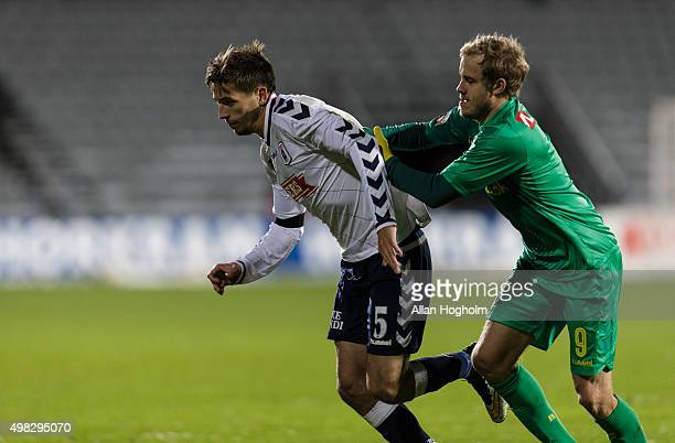 Alexander Juel Andersen of AGF and Teemu Pukki of Brondby IF compete for the ball during the Danish Alka Superliga match between AGF Aarhus and...