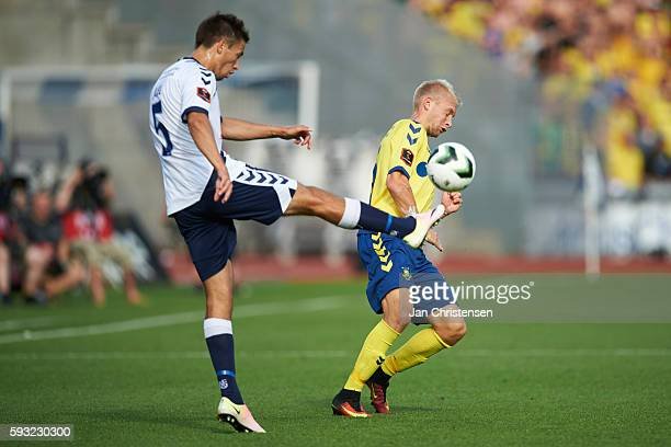 Alexander Juel Andersen of AGF Arhus and Johan Larsson of Brondby IF compete for the ball during the Danish Alka Superliga match between AGF Arhus...