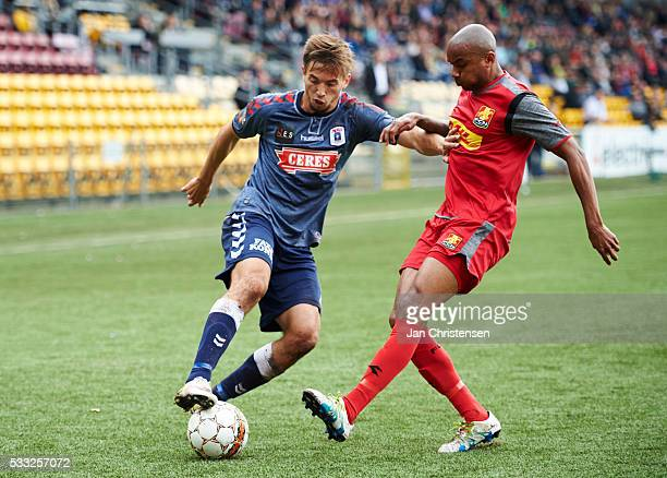 Alexander Juel Andersen of AGF Arhus and Joshua John of FC Nordsjalland compete for the ball during the Danish Alka Superliga match between FC...