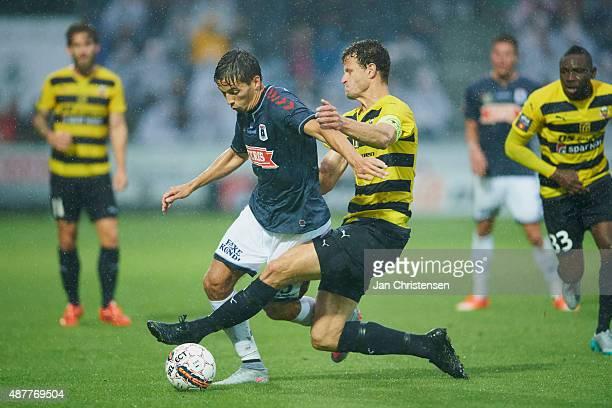 Alexander Juel Andersen of AGF Arhus and Mads Justesen of Hobro IK compete for the ball during the Danish Alka Superliga match between Hobro IK and...