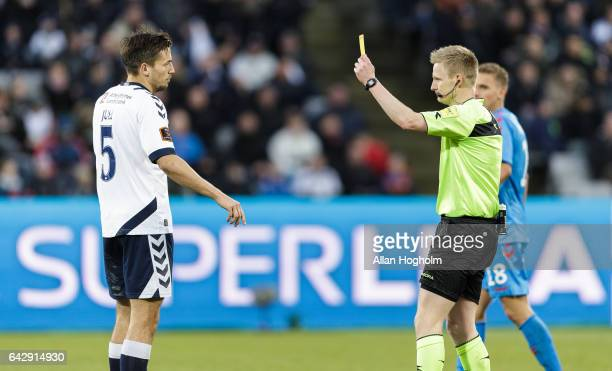 Alexander Juel Andersen of AGF receives a yellow card from Referee Jorgen Daugbjerg Buchardt during the Danish Alka Superliga match between AGF...