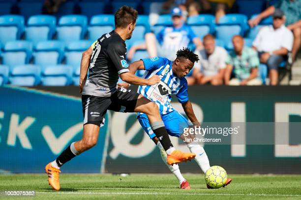 Alexander Juel Andersen of Vendsyssel FF and Emmanuel Oti Essigba of Esbjerg fB compete for the ball during the Danish Superliga match between...