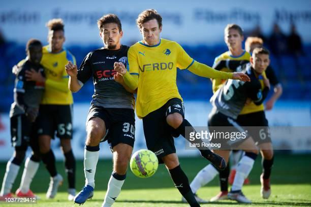 Alexander Juel Andersen of Vendsyssel FF and Erik Marxen of Randers FC $cm$ the Danish Superliga match between Randers FC and Vendsyssel FF at...