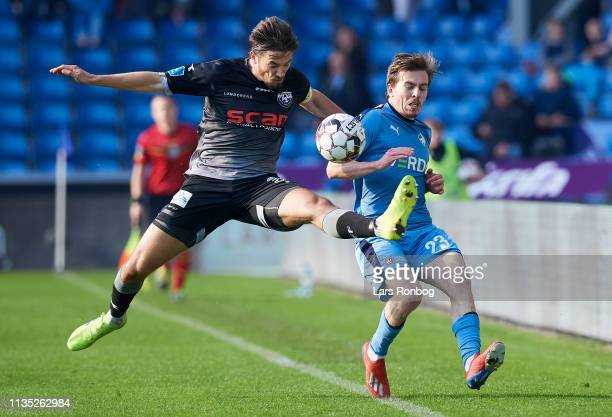 Alexander Juel Andersen of Vendsyssel FF and Saba Lobjanidze of Randers FC compete for the ball during the Danish Superliga match between Randers FC...