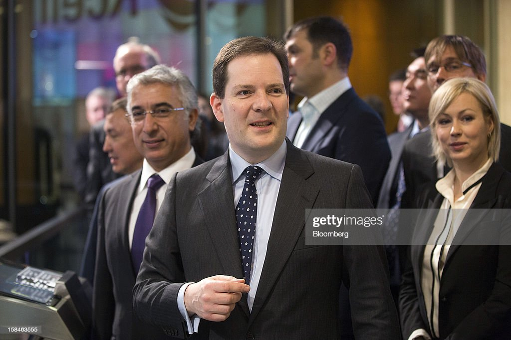 Alexander Justham, chief executive officer of London Stock Exchange Plc, center, attends the initial public offering (IPO) launch of Kcell, a unit of TeliaSonera AB, at the London Stock Exchange in London, U.K., on Monday, Dec. 17, 2012. Kcell, which has 11.6 million subscribers, is the largest operator in Kazakhstan with a subscriber market share of about 48 percent and a revenue market share of 57 percent, Chief Executive Officer Veysel Aral said. Photographer: Simon Dawson/Bloomberg via Getty Images