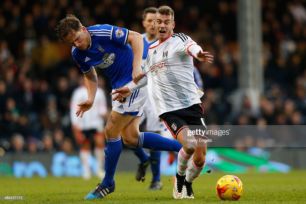 Alexander Kacaniklic of Fulham is fowled by Christophe Berra of Ipswich Town during the Sky Bet Championship match between Fulham and Ipswich Town at Craven Cottage on February 14, 2015 in London, England.