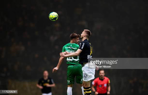 Alexander Kacaniklic of Hammarby IF and Karol Mets of AIK competes for the ball during the Allsvenskan match between Hammarby IF and AIK at Tele2...