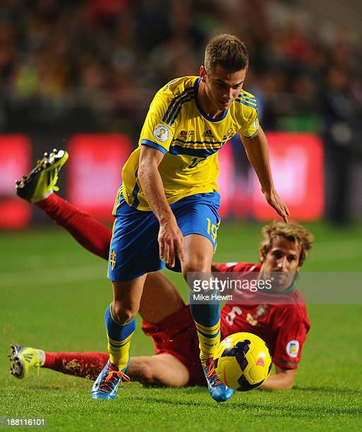 Alexander Kacaniklic of Sweden gets past Fabio Coentrao of Portugal during the FIFA 2014 World Cup Qualifier Playoff First Leg between Portugal and...