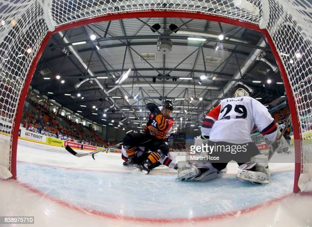Alexander Karachun of Wolfsburg fails to score over Jan Lukas goaltendender of Bystrica during the Champions Hockey League match between Grizzlys...