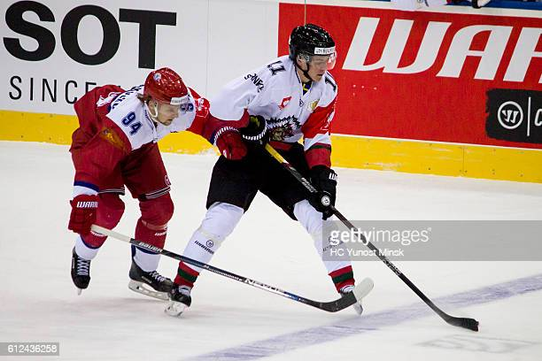 Alexander Karakulko of Yunost Minsk trys to take the puck from Victor Olofsson of Frolunda Gotenburg during the 1st period of Champions Hockey League...