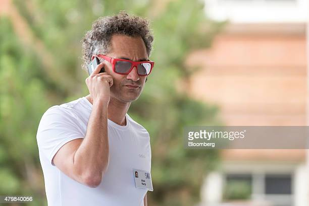 Alexander Karp chief executive officer and cofounder of Palantir Technologies Inc speaks on a mobile phone as he arrives for the Allen Co Media and...