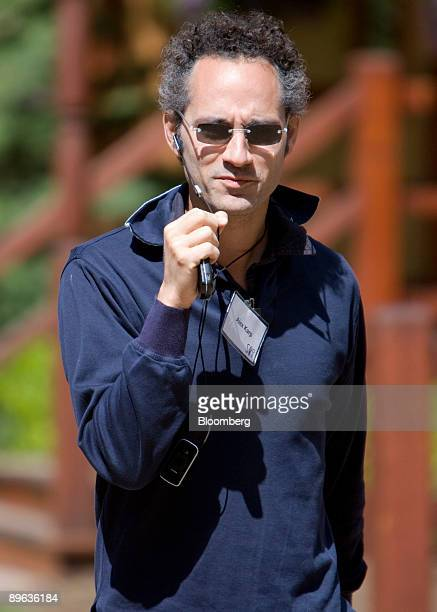 Alexander Karp chief executive officer and cofounder of Palantir Technologies Inc talks on his mobile phone during the Allen Co Media and Technology...