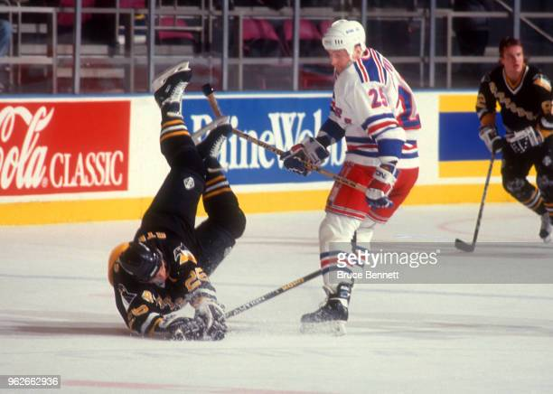 Alexander Karpotsev of the New York Rangers checks Kevin Stevens of the Pittsburgh Penguins during an NHL game circa 1994 at the Madison Square...