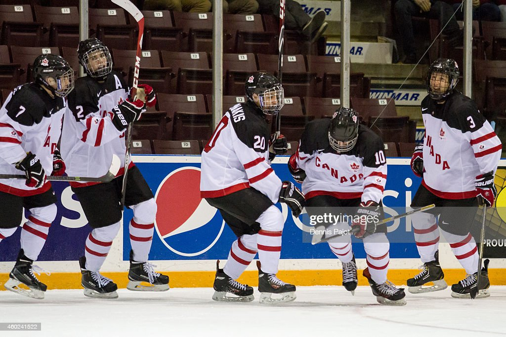 Alexander Katerinakis #20 and Tyson Jost #10 of Canada White celebrate a goal against Finland during the World Under-17 Hockey Challenge on November 2, 2014 at the RBC Centre in Sarnia, Ontario.