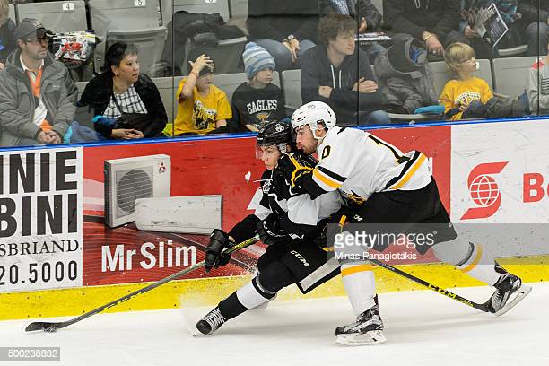 Alexander Katerinakis of the BlainvilleBoisbriand Armada skates with the puck against Dillon Boucher of the Cape Breton Screaming Eagles during the...