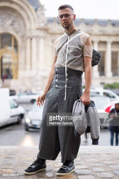 Alexander Kealvean is seen attending Paco Rabanne during Paris Fashion Week wearing a linen shirt with grey pants on September 28 2017 in Paris France