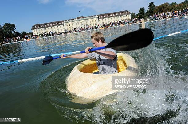 Alexander Kempt paddles past the Baroque Palace in a hollowed out pumpkin as he takes part in the German Pumpkin Boat Championship on September 16...