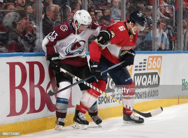 Alexander Kerfoot of the Colorado Avalanche and Alex Petrovic of the Florida Panthers battle along the boards at the BBT Center on December 9 2017 in...