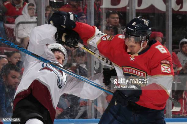 Alexander Kerfoot of the Colorado Avalanche battles with Alex Petrovic of the Florida Panthers at the BBT Center on December 9 2017 in Sunrise...