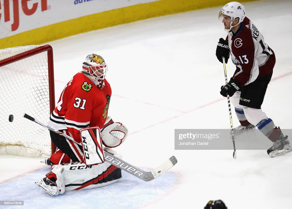 Alexander Kerfoot #13 of the Colorado Avalanche scores a goal late in the third period against Anton Forsberg #31 of the Chicago Blackhawks at the United Center on March 20, 2018 in Chicago, Illinois. The Avalanche defeated the Blackhawks 5-1.