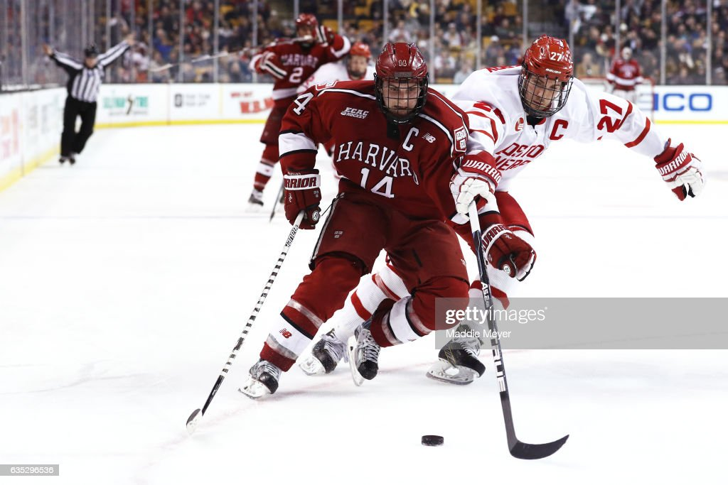 Alexander Kerfoot #14 of the Harvard Crimson and Doyle Somerby #27 of the Boston University Terriers battle for control of the puck during the second period of the 2017 Beanpot Tournament Championship at TD Garden on February 13, 2017 in Boston, Massachusetts.