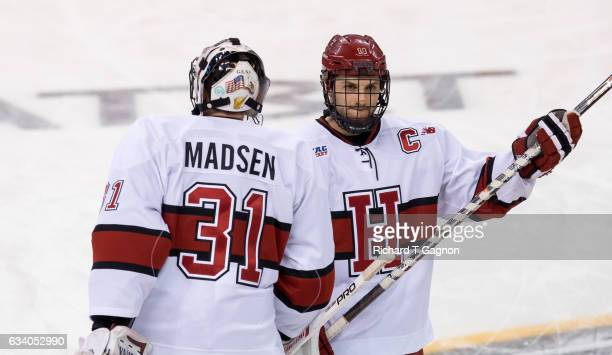 Alexander Kerfoot of the Harvard Crimson and teammate Merrick Madsen warm up before NCAA hockey in the semifinals of the annual Beanpot Hockey...