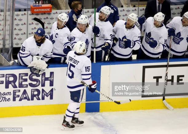 Alexander Kerfoot of the Toronto Maple Leafs is congratulated by teammates on the bench after he scored in the second period against the Montreal...