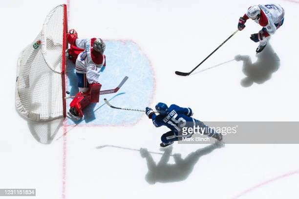 Alexander Kerfoot of the Toronto Maple Leafs shoots against Carey Price of the Montreal Canadiens during the first period at the Scotiabank Arena on...