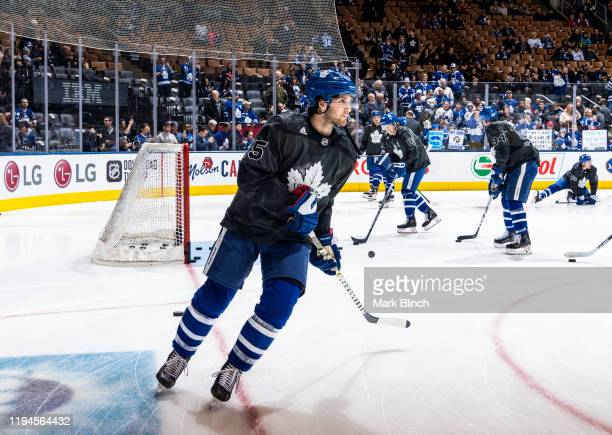 Alexander Kerfoot of the Toronto Maple Leafs wears a jersey honouring the Canadian Armed Forces during warmup before facing the Chicago Blackhawks at...