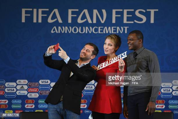 Alexander Kerzhakov and Marcel Desailly pose for a selfie with Yana Churikova Russian TV Host and 2018 FIFA World Cup Ambassador during the...