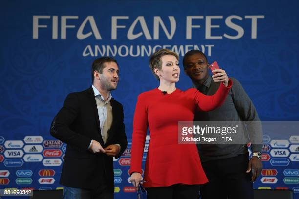 Alexander Kerzhakov Yana Churikova and Marcel Desailly pose for a selfie during the announcement of the new 2018 FIFA Fan Fest Ambassadors for the...