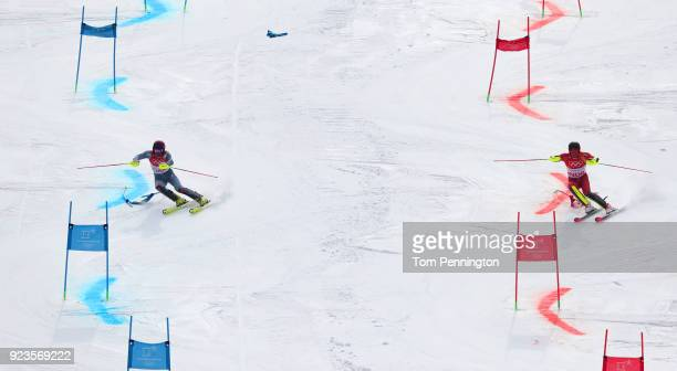 Alexander Khoroshilov of Olympic Athlete From Russia and Leif Kristian NestvoldHaugen of Norway compete during the Alpine Team Event 1/8 Finals on...