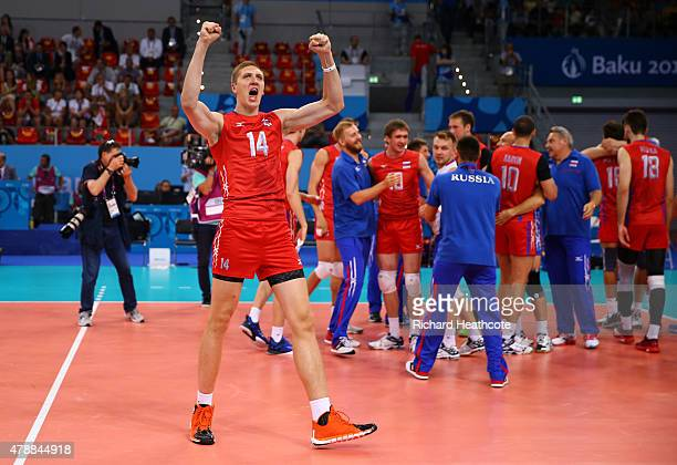 Alexander Kimerov of Russia celebrates with team mates as they win bronze in the the Men's bronze medal match between Poland and Russia on day...
