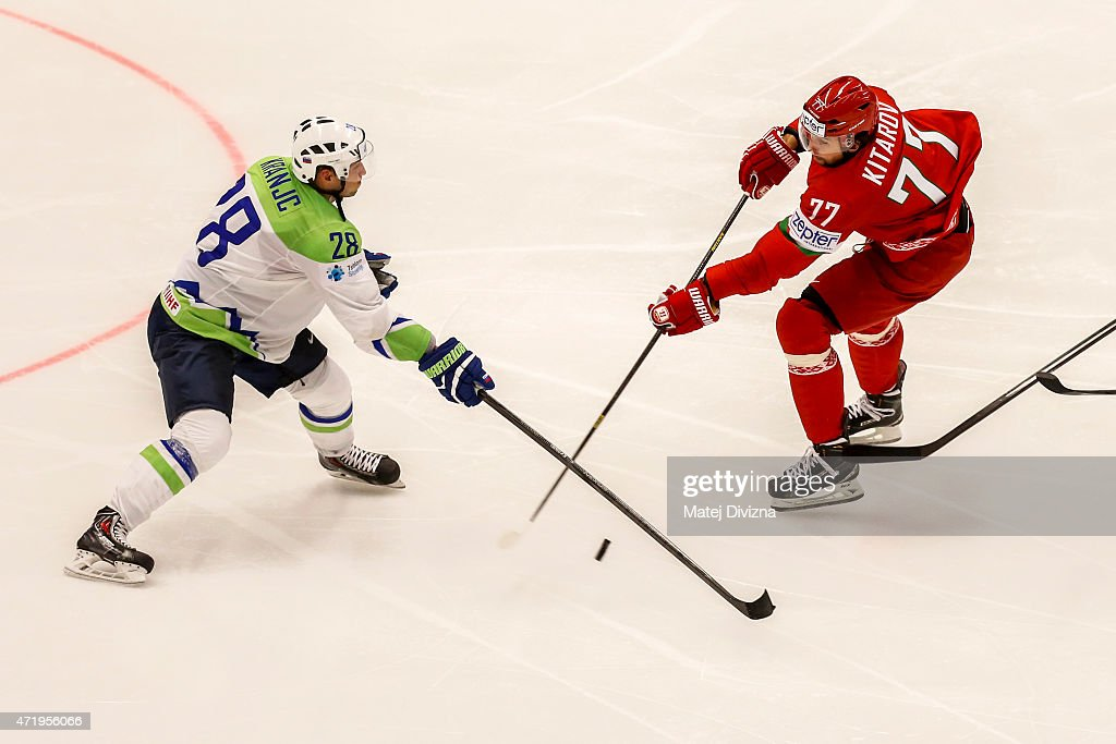 Alexander Kitarov (R) of Belarus and Ales Kranjc (L) of Slovenia battle for the puck during the IIHF World Championship group B match between Belarus and Slovenia at CEZ Arena on May 2, 2015 in Ostrava, Czech Republic.