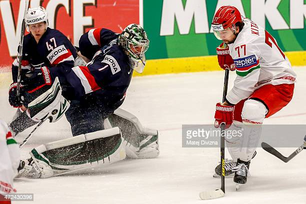 Alexander Kitarov of Belarus scores over Jack Campbell, goalkeeper of USA, during the IIHF World Championship group B match between USA and Belarus...