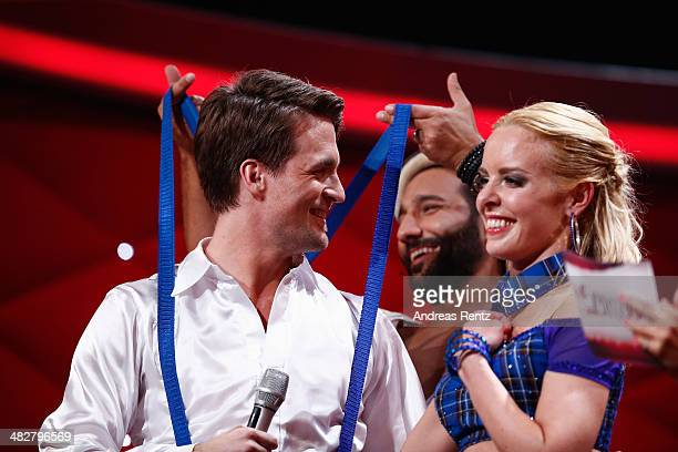 Alexander Klaws and Isabel Edvardsson smile while Massimo Sinato laughs during the 2nd Show of 'Let's Dance' on RTL at Coloneum on April 4 2014 in...