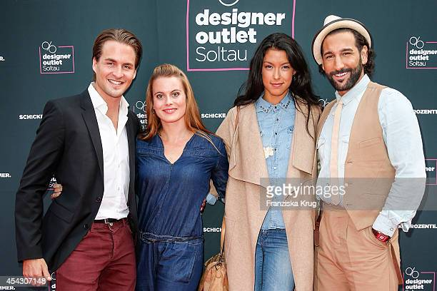Alexander Klaws Nadja Scheiwiller Rebecca Mir and Massimo Sinato attend the Late Night Shopping Designer Outlet Soltau on August 28 2014 in Soltau...