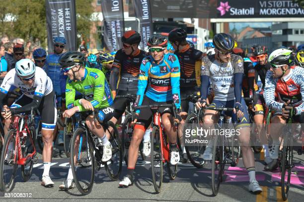 Alexander Kristoff Green Jersey August Jensen BlueOrange Leader Jersey Dylan Teuns a rider from Aqua Blue Sport Team and Bernhard Eisel at the start...