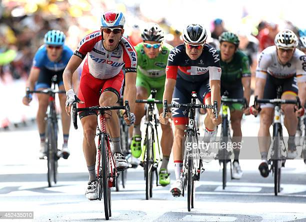 Alexander Kristoff of Norway and Team Katusha celebrates winning in front of Heinrich Haussler of Australia and Iam Cycling, Peter Sagan of Slovakia...