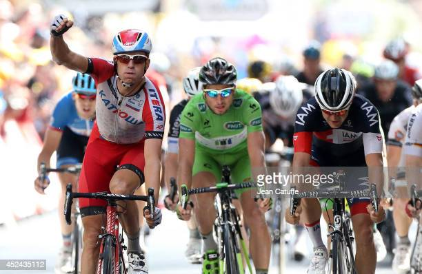 Alexander Kristoff of Norway and Team Katusha celebrates winning in front of Heinrich Haussler of Australia and Iam Cycling and Peter Sagan of...